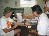 At the Furnace Creek Medical HQ, we teach Kent to work the iSTAT machine, and we practice on each other.