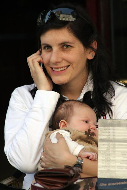 Woman, baby, phone in restaurant