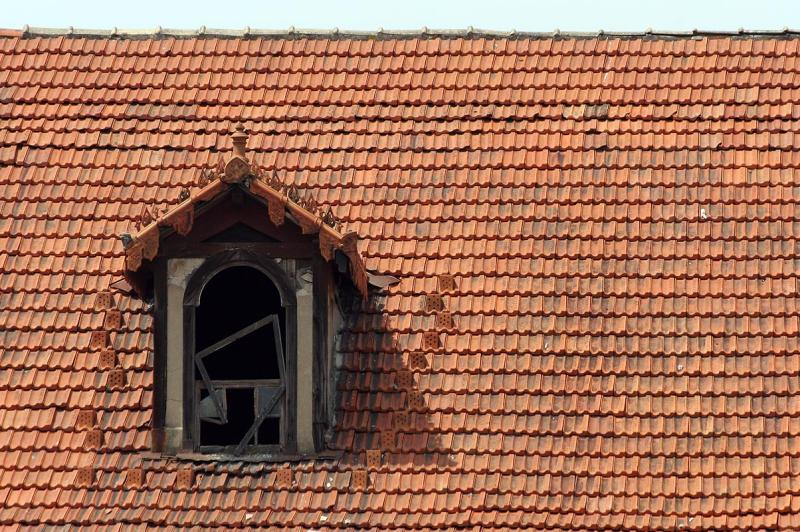 Tiled roof and dilapidated attic