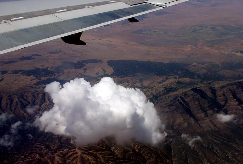 Wing, cloud, mountain