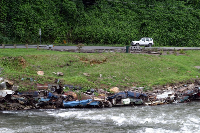 Scenic Waterway With Abandoned Cars