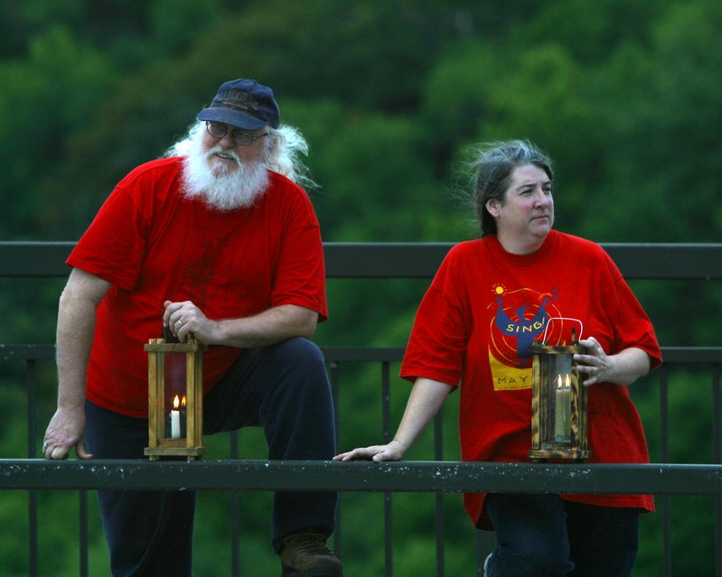 Two in Red Shirts with Candles