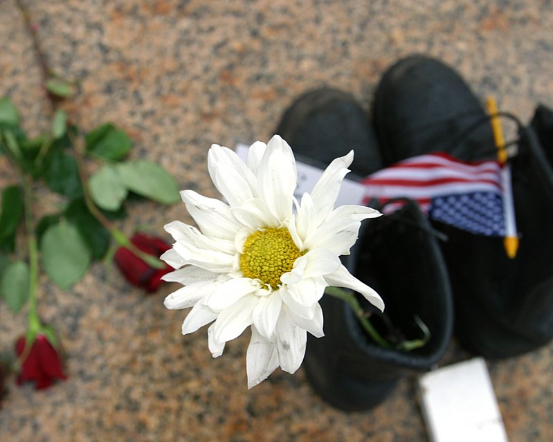 Boots of fallen Soldier with Daisy