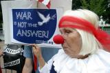 War is not the answer held by sad-faced clown
