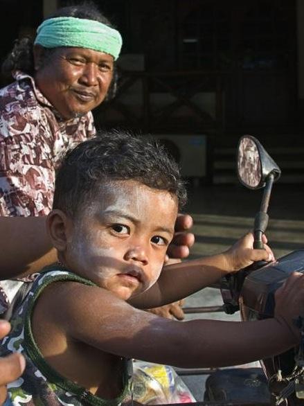 Young Thai boy biker glancing