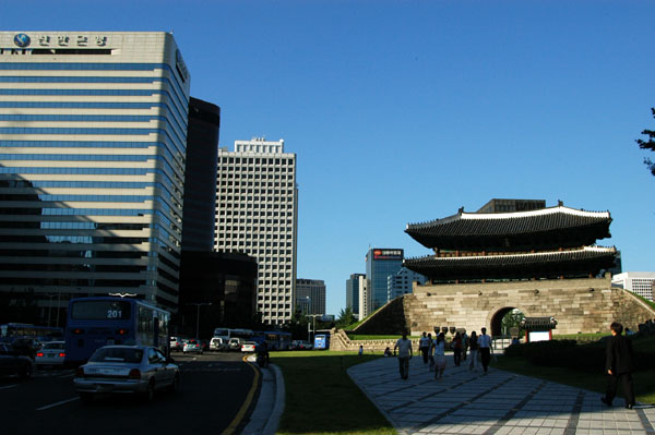Namdaemun Gate surrounded now by tall buildings