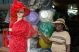 Dora Lamptey of God Is God Collectibles showing off hats she makes herself