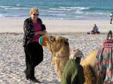 Mom and the camel on the beach