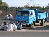 Workers hanging around Buraimi
