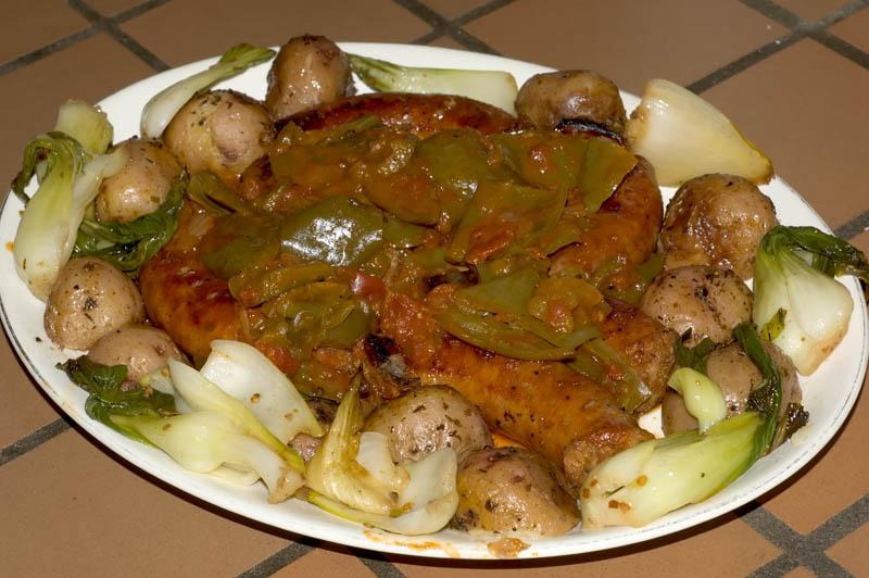 sausages with peperonata sauce, pan roasted potatoes, sauteed baby bok choi