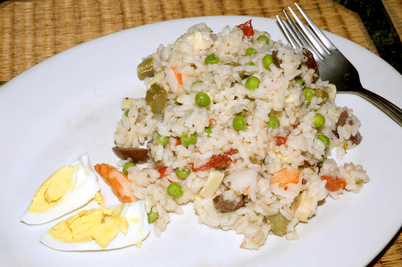 italian style rice salad with cheese, shrimp, peas, pickles, olives, tuna