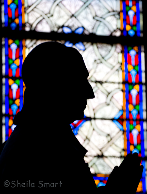 Statue silhouette at Notre Dame cathedral
