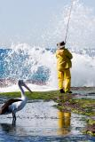 Fisherman with pelican