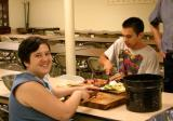 Food Not Bombs prepares a delicious meal
