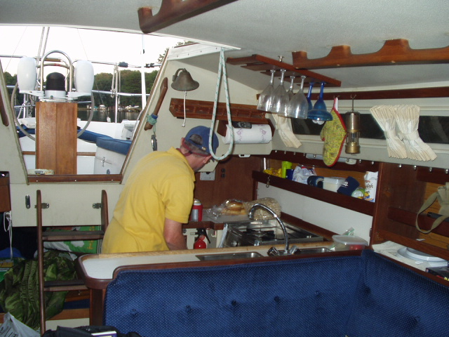 At anchor, the ships captain in the galley