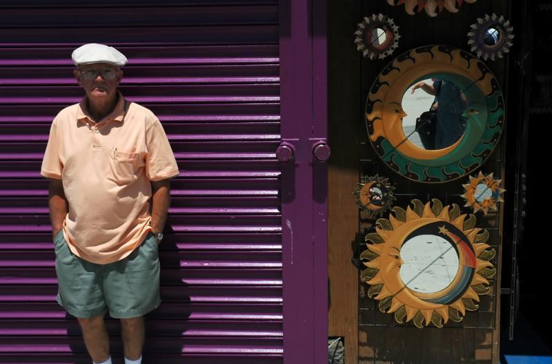 Old man standing on the boardwalk in Venice Beach