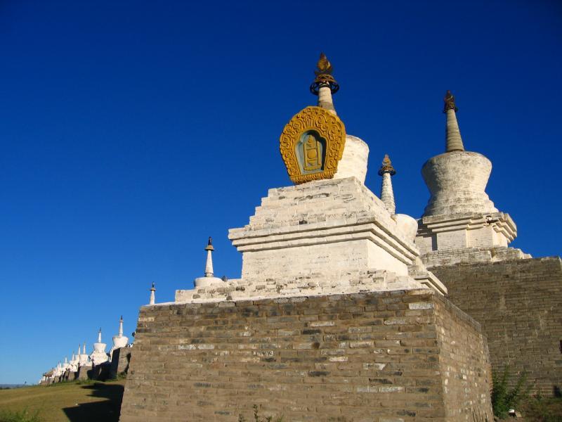 Line of stupas atop the monastery walls