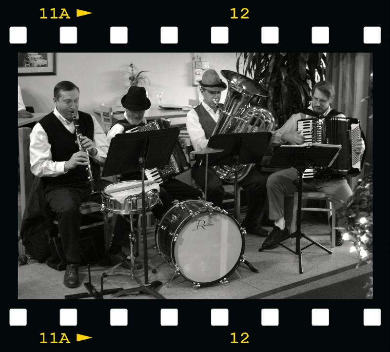 Musicians playing during Oktoberfest at Continental Bistro DSCF0747.jpg