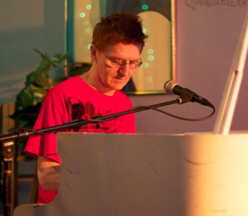 At the piano