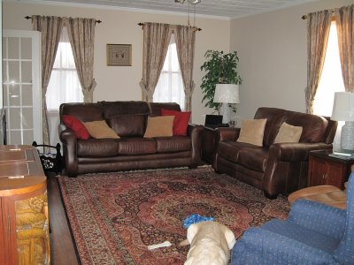 I Mixed Leather Colors In My Livingroom. Chocolate Sofa And Loveseat With A  Carmel Leather Chair.