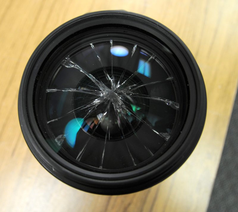 Lens with shattered front element