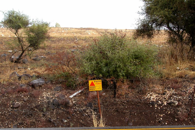 Minefield warning sign next to a road in the Golan Heights. Mines were deployed by the Syrian army and some remain active.