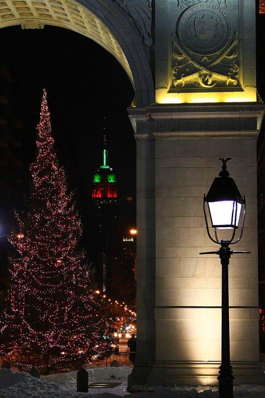 Under Washington Square Arch at night