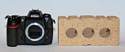 $1800 Nikon Vs. a Brick