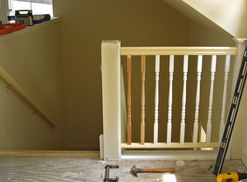 Railing in place, constructing newel post