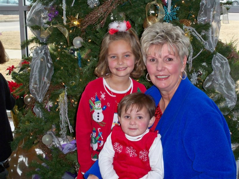 Christmas 08 Jo Ann Solomon, with grand children Taylor and Hunt.