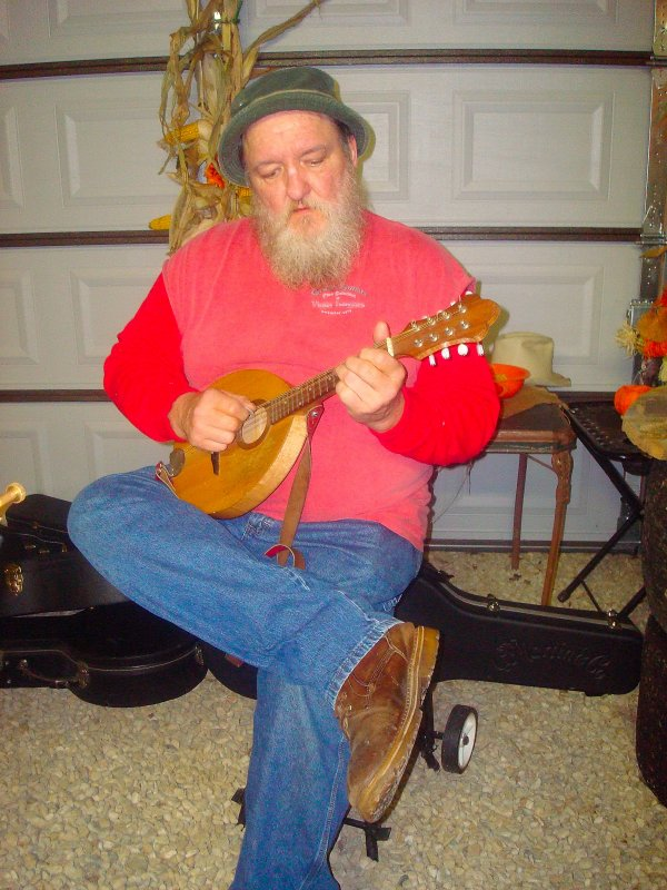 Hillbilly Jim playing the mandolin