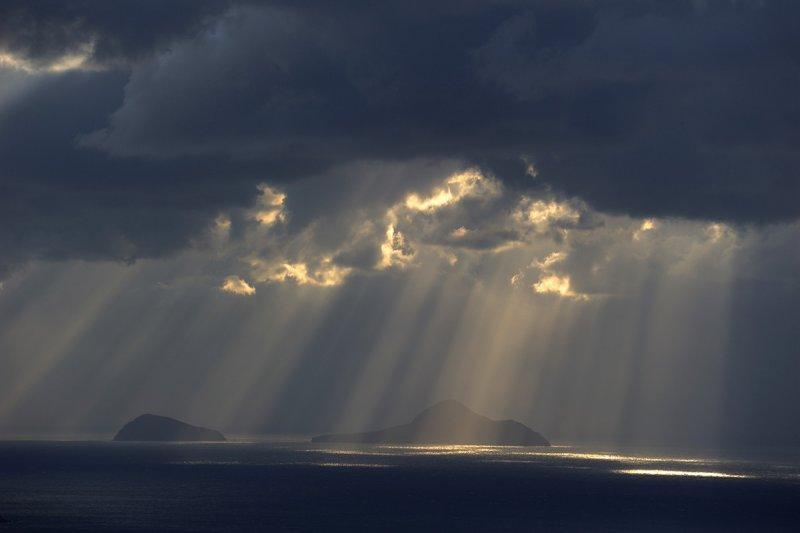 Santorini. Hristiana island under the sun beams