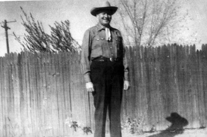 Bill in front of a fence he built