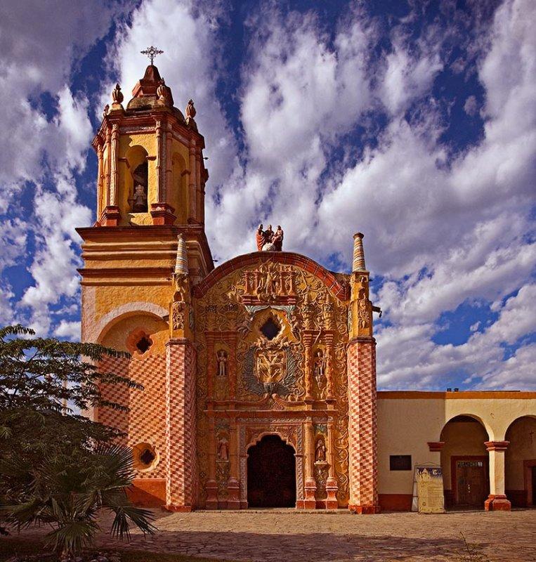 San Miguel Concá against a dramatic sky.