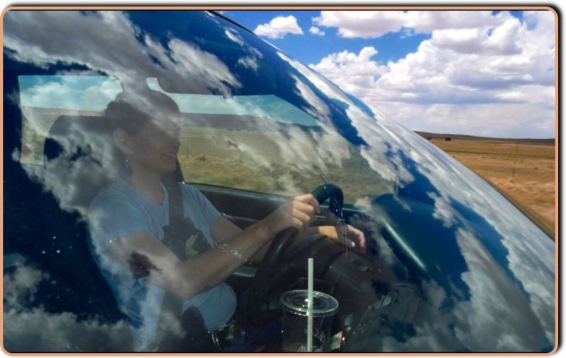 Big Sky Reflection at 60mph over Jeans Windshield