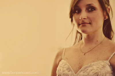 Candid portrait of a bride in the bridal suite just after she put on her wedding dress.