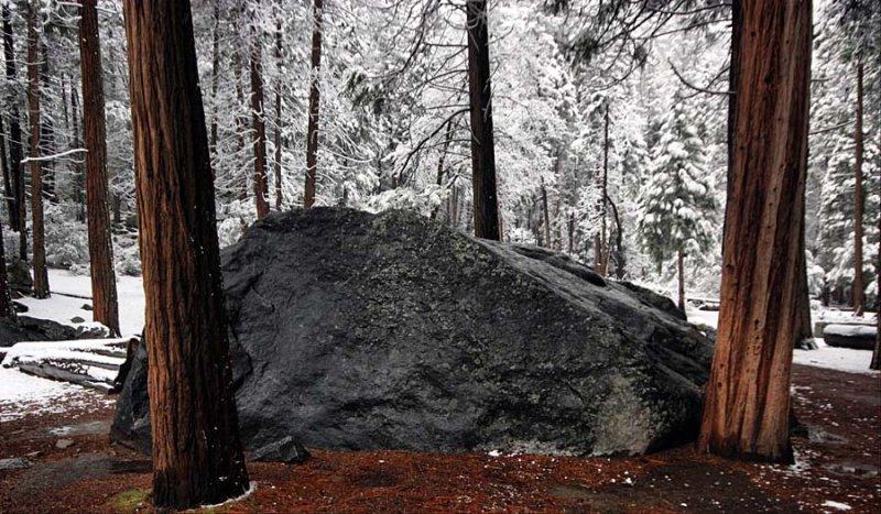 Boulder in fresh snow