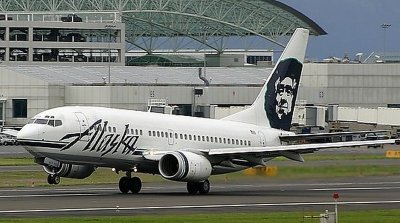 WE FLEW ON ALASKA AIRLINES AND THAT IS AN ESKIMO NOT FIDEL CASTRO ON THE TAIL