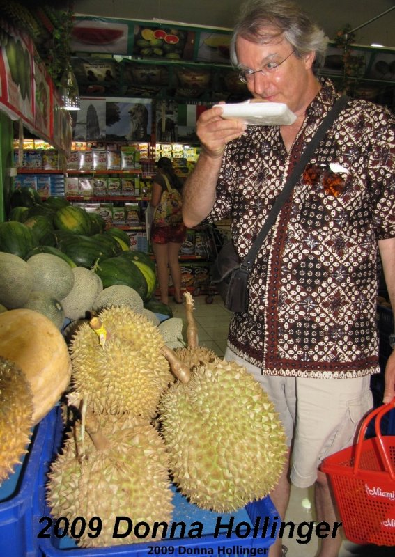 Peter smelling the durian