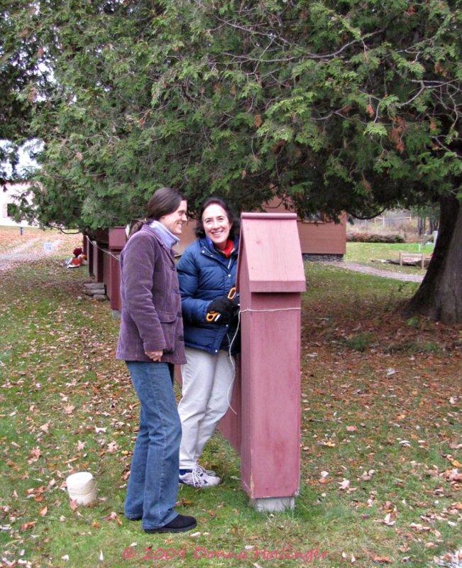 Ingrid and AnMari putting up Apple Art