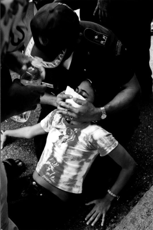 Girl Overcome By Tear Gas.jpg