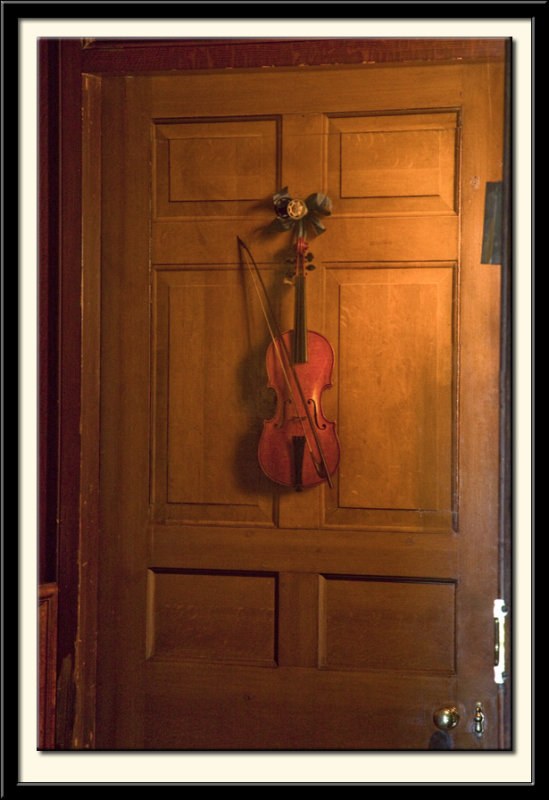 Trompe lOeil Violin and Bow Hanging on a door, c.1723