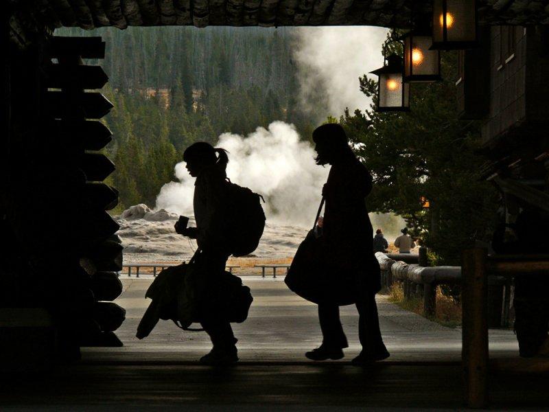 Tourists departing Old Faithful Inn, Yellowstone National Park, Wyoming, 2008