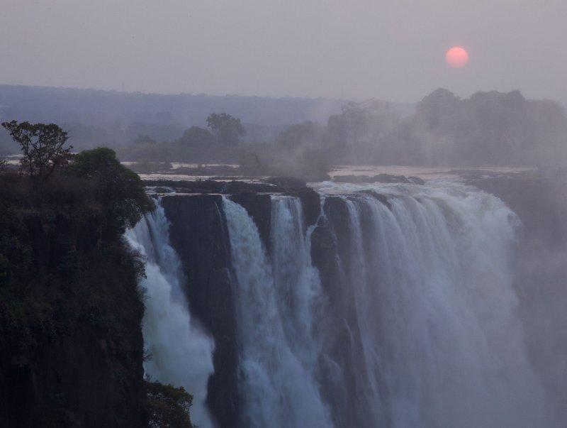 sunrise over victoria falls, zimbabwe