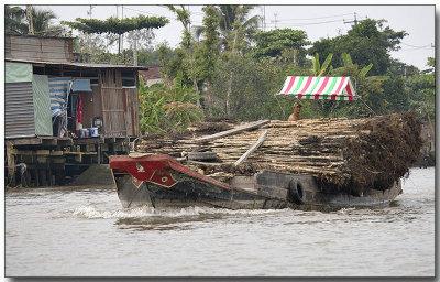 Lumber for river houses - Floating Market