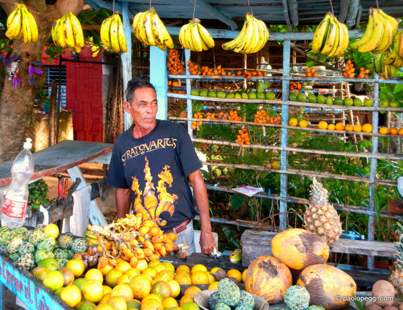 A cuban man selling fruit and vegetable in Cienfuegos, Cuba