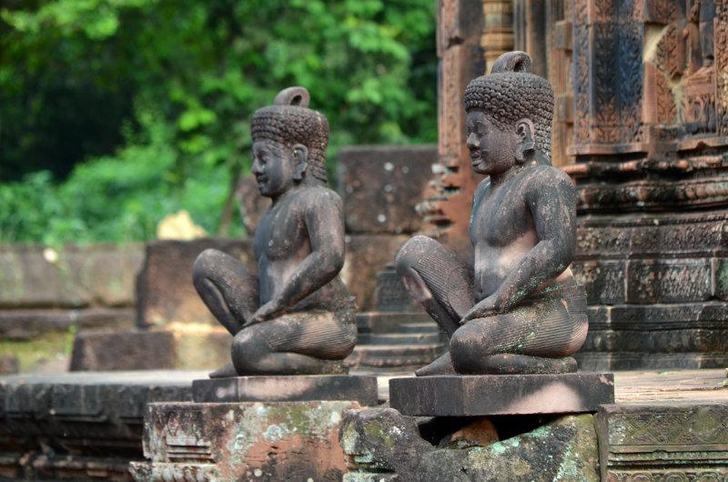 Banteay Srei Guarded by Two Kneeling Statues