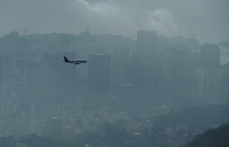Seen from the Corcovado: airplane landing in Santos Dumont airport.