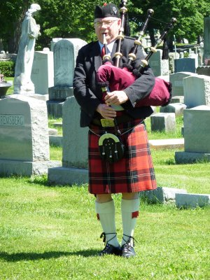 A bagpiper greeted us