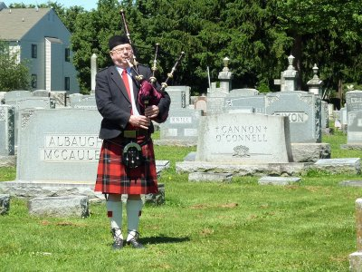 The bagpiper played, & keeping our distance, we expressed our sympathy to Beth.